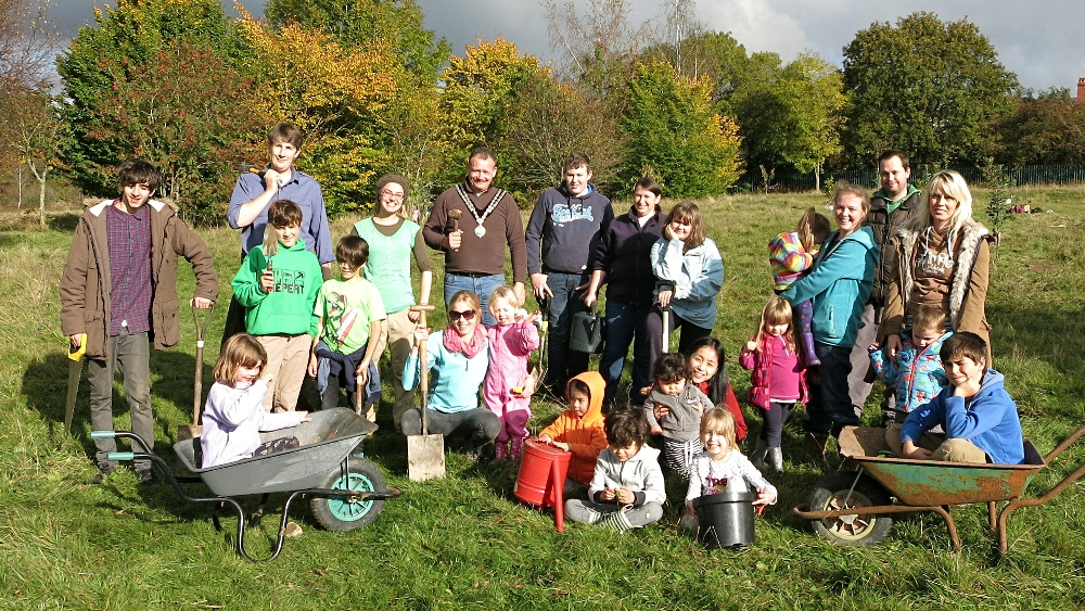 Happy planters in the community orchard